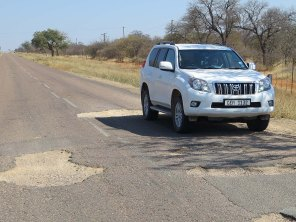 The potholed road